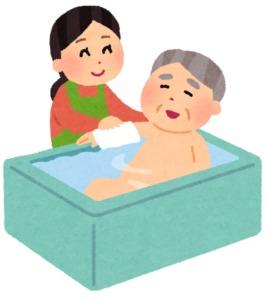 入浴介助を行う介護職員
